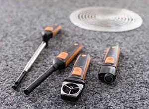 Testo VAC Set layed on the ground near a drain